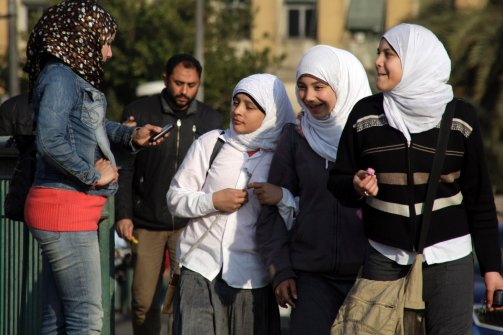 Egyptian school girls walk in Cairo, Egypt, on March 7, 2012 (Photo credit: Amr Nabil/AP Photo).
