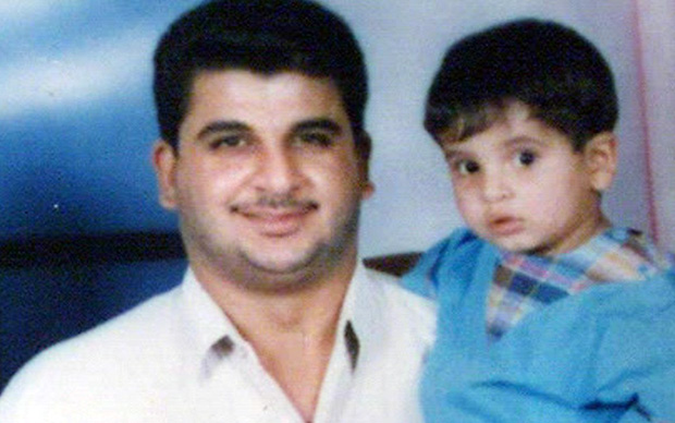Baha Mousa with his son. Mousa died while held by British forces at an interrogation centre in Basra in 2003. (Photo credit: Eddie Mulholland)