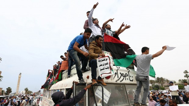 Libyan protesters demonstrate in support of the political isolation law
