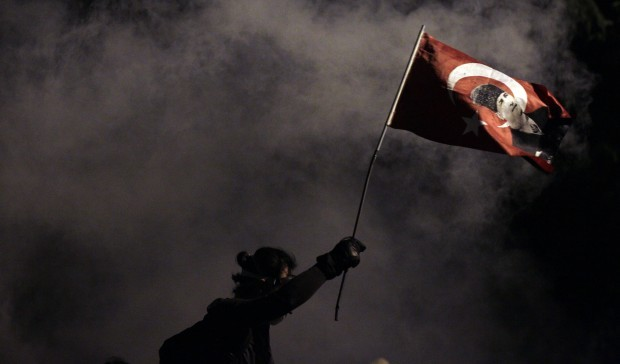 A Taksim Square protestor waves a Turkish flag