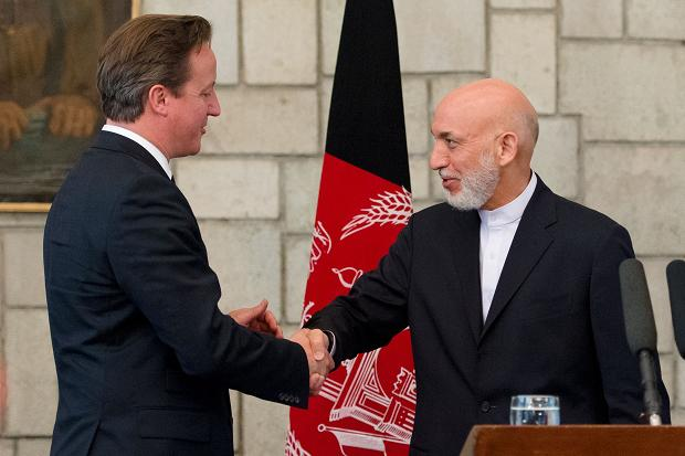 President Karzai committed to talks with the Taliban at a press conference in Kabul with British Prime Minster David Cameron.
