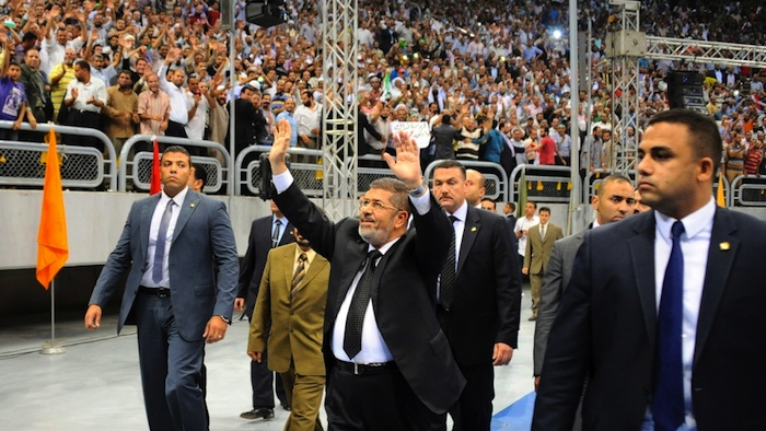President Morsi arrives at the 'Syrian victory' conference (Photo: AP)