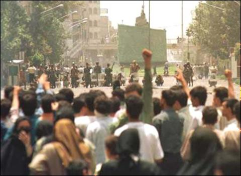 Students face riot police near the University of Tehran, July 13, 1999. (AP Photo / Kamran Jebreili)
