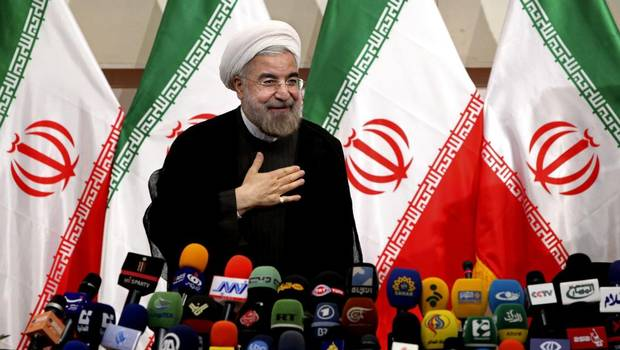 President Rouhani at a press conference in Tehran (AP)