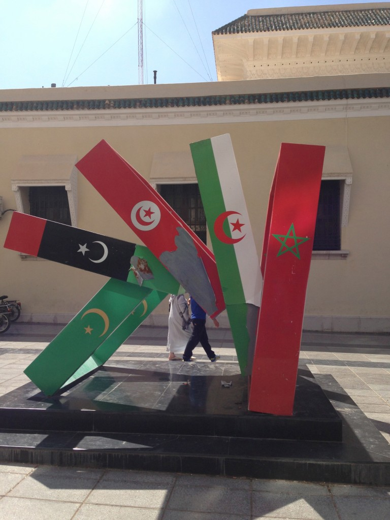 Maghreb United? A sculpture in Oujda, Morocco depicting the flags of Mauritania, Libya, Tunisia, Algeria, and Morocco, complete with the post-Gaddafi flag of Libya (Source: photo by author)