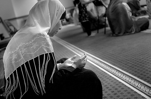 A woman praying at a local mosque