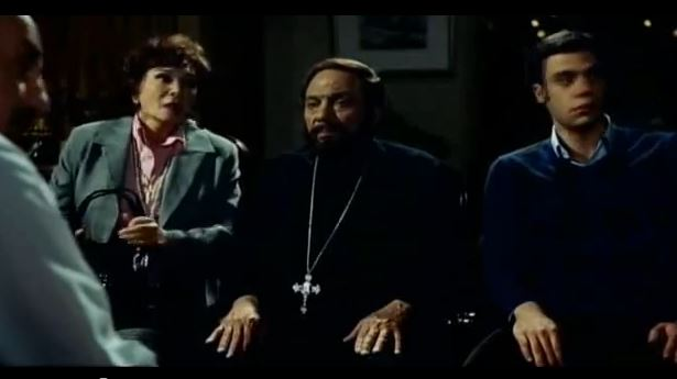 Adel Imam (in the middle) wearing Coptic garb.
