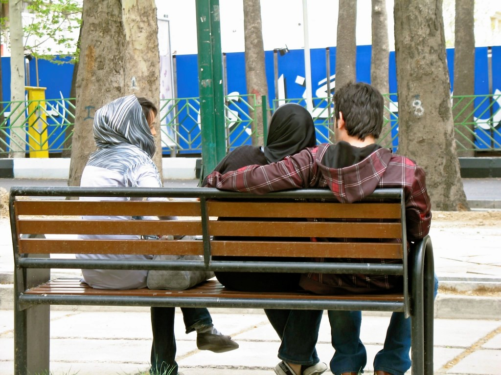 Young Iranians relax in Mellat Park in northern Tehran, April 2010. (Photo Credit: Nima Shirazi)