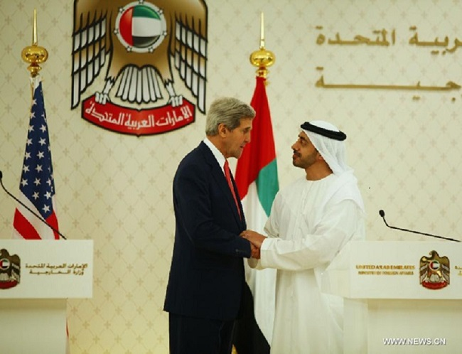 Sheikh Abdullah bin Zayed al-Nahyan with his counterpart John Kerry (photo credit: Xinhua)