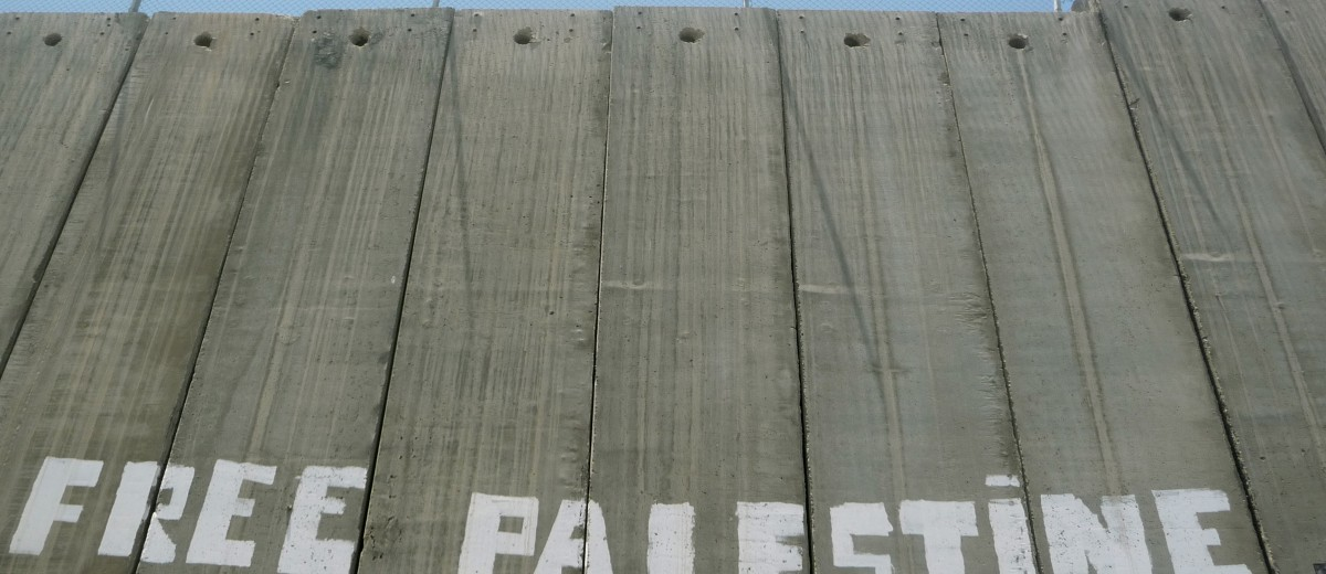 """Photo caption: """"The Wall (Photo credit: http://postcardsfrompalestine.wordpress.com/category/west-bank-wall/)"""""""