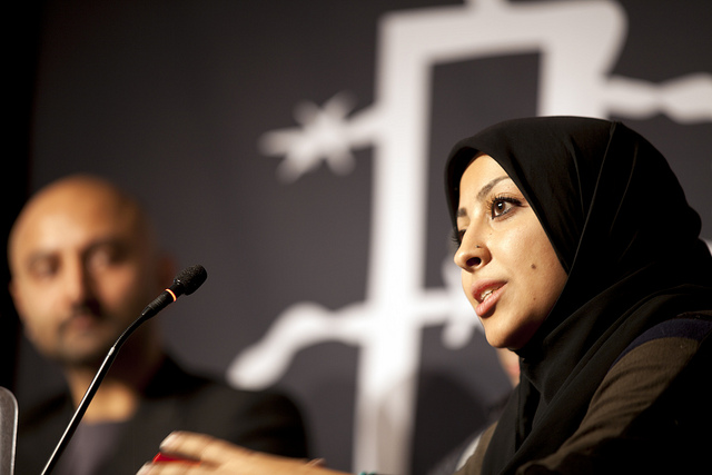 Maryam al-Khawaja speaking at an Amnesty International conference, by Flickr user amnestystudent