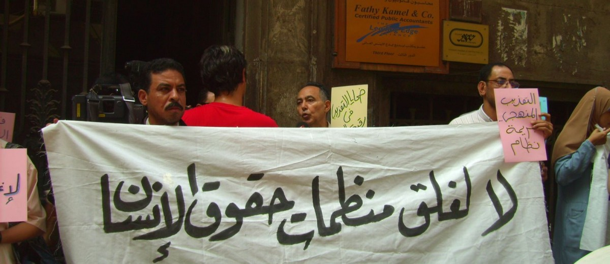 Demonstrators protest the closing of human rights organizations in Cairo.