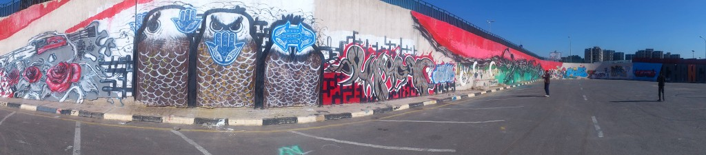 The graffiti mural that continues to dominate Al Saidi Street in Tripoli. (Photo credit: OMCT)