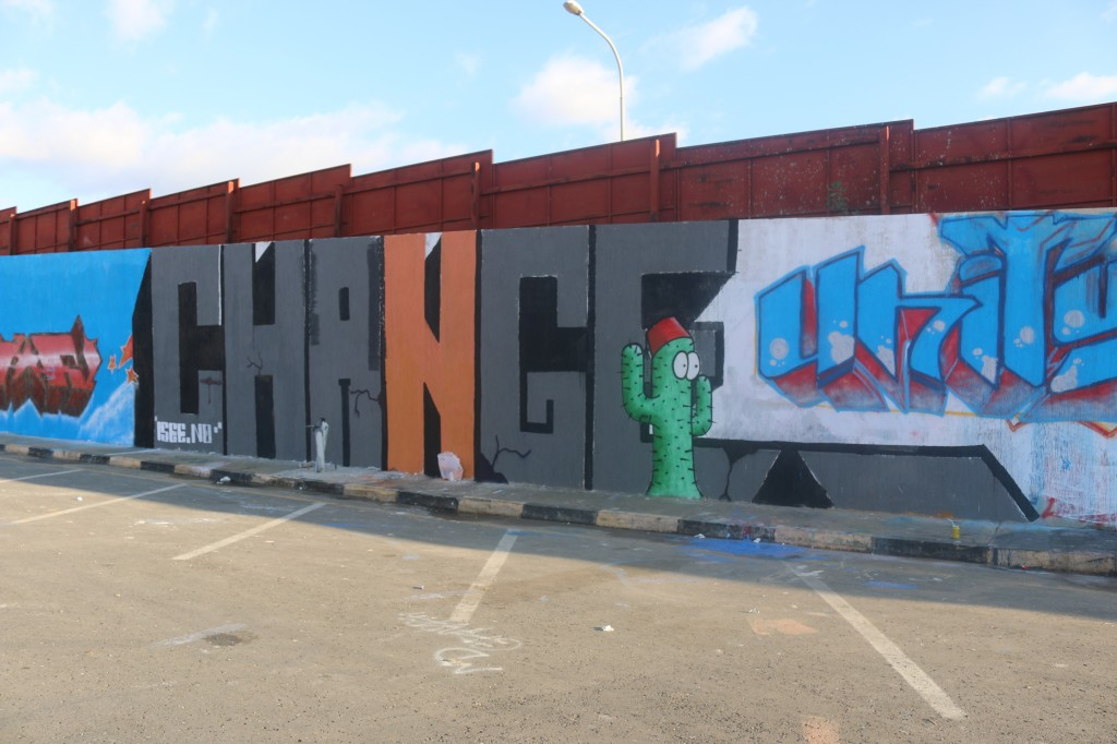 """Elmalti's graffiti piece """"Change"""" right after completion in December 2013. To this day, it remains on Al Saidi Street. (Photo credit: OMCT)"""