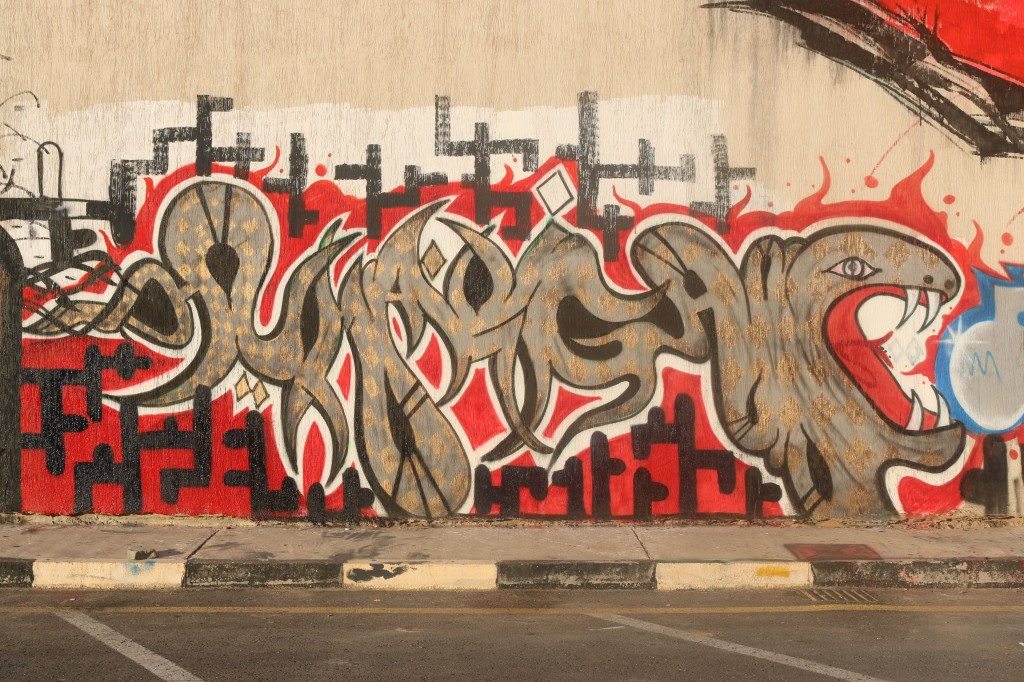 "Ray-One's graffiti piece ""Human Rights"" after its completion in December 2013. As of this writing, it can still be seen on Al Saidi Street. (Photo credit: OMCT)"