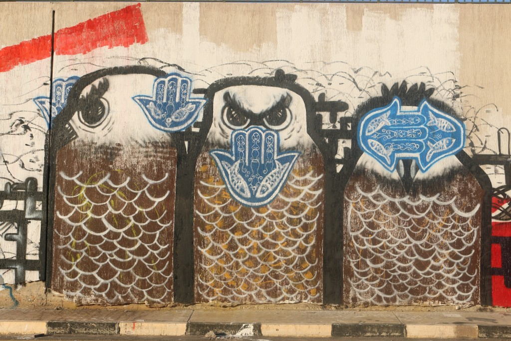 El Bohly's graffiti piece in Tripoli after completion in December 2013. It is no longer possible to see it on Al Saidi street, as it has been partly erased. (Photo Credit: OMCT)