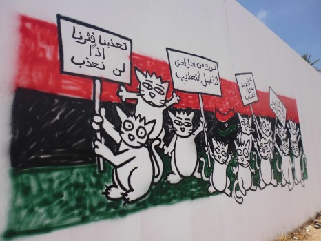 "Willis from Tunis graffiti piece after completion in June 2013. In Arabic, it says ""We were tortured so we won't torture. A revolution for the rights, we will not accept torture"" (Photo credit: Khaled Alkwafi/OMCT)"
