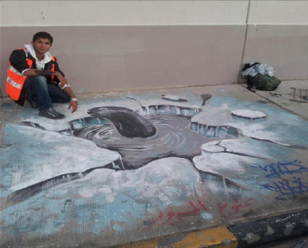 Anas Mohammed and Mohammed Shandool's 3D graffiti piece for the Camp 77 event, with a member of Flame of the Capital posing next to it, Tripoli, December 2012 (Photo credit: Anas Mohammed).
