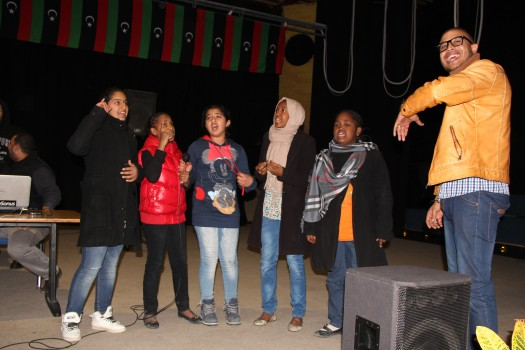 Mohamed Alhmozzy with children in the music workshop in Zawett al Dahmani theater, Tripoli, December 2013. (Photo credit: OMCT)