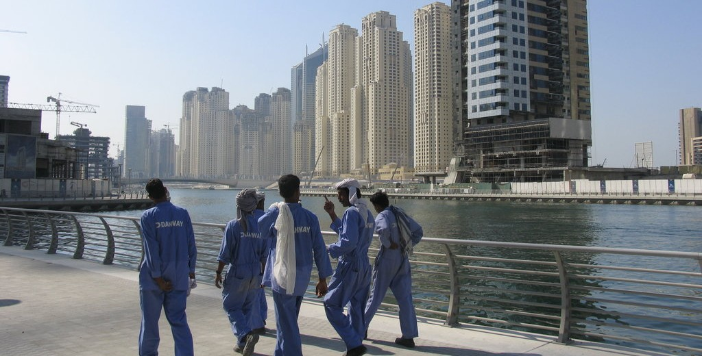 Workers taking a stroll in the Dubai Marina during a break. November 25, 2006. Photo Credit: Paul Keller /Flickr