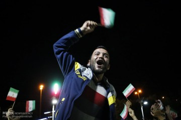 An Iranian man in Hamedan joins others in celebrating the announcement of a final deal between Iran and the P5+1 countries, July 15, 2015. Photo Credit: Iman Hamikhah/Mehr News Agency