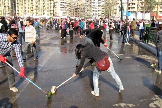 Protesters and volunteers sweep Tahrir Square, during the Egyptian Revolution of 2011, a day after Hosni Mubarak's resignation as president, in a gesture of a new beginning. Date12 February 2011 (credit: Wikipedia).
