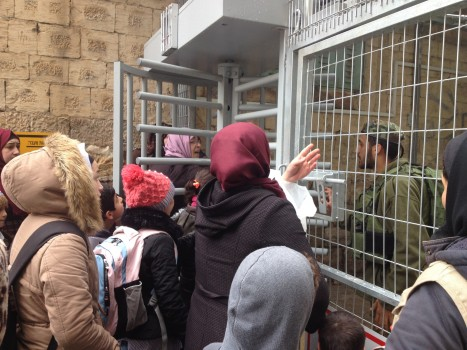 Palestinians attempting to enter Shuhada Street held outside checkpoint 59 [Photo: EAPPI/Sabrina Tucci]