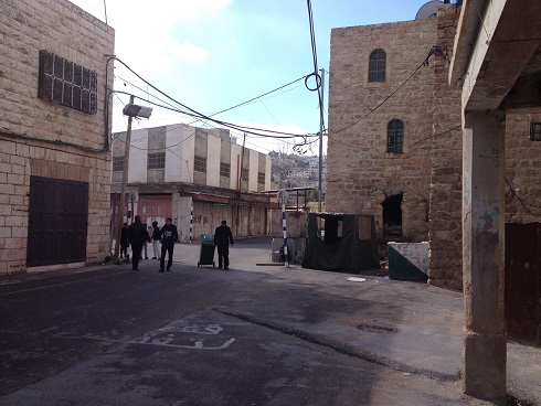 """Picture 1: """"White line"""" checkpoint between Shuhada Street and the road to the Ibrahimi Mosque [Photo: EAPPI/Sabrina Tucci]"""