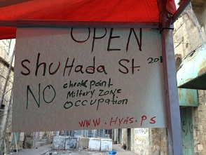 Picture 4: Banner calling for an end to the closed military zone [Photo: EAPPI/Sabrina Tucci]