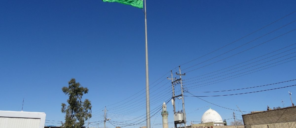Kurdish flag flying over Erbil