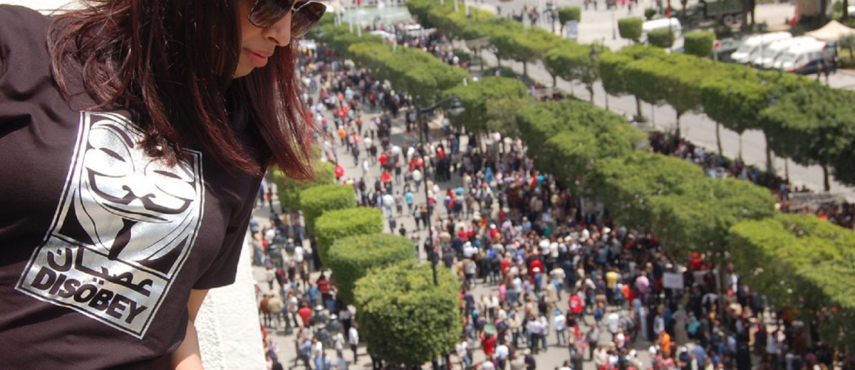Woman overlooks protests in Tunisia